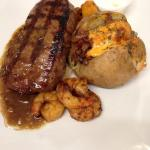 Striploin with Cajun Shrimp and Loaded Baked Potato