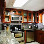 Handmade wood cabinets with fully equipped kitchens