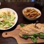 Summer Pesto Chicken sandwich with Caesar salad and fries.