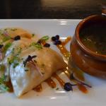 Steamed Asian chicken dumplings and clear broth