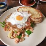 Delicious breakfast, smoked trout on potato mash with fried egg