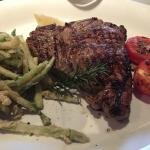 TBone with zucchini chips and grilled tomato