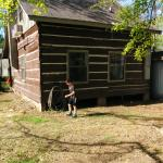 back of cabin where boys were playing hide and seek tag