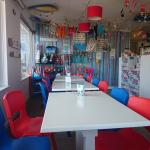 Cafe Coast Porth inside colourful seatings