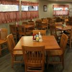 Our newly renovated main dining area with new floors, paint, curtains and tables and chairs.