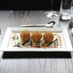 Black pudding & goats cheese bon bons on fennel seeded confit courgette.