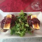Appetizer of steak with brie and cranberry sauce