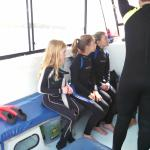 girls getting diving instructions before day one dive