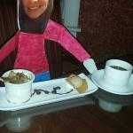 Flat Jaclyn enjoying cinnamon bread pudding and coffee after dinner