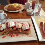 French toast w/ side eggs and bacon, and eggs Benedict with crab