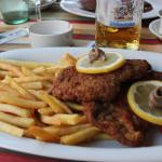 Weinerschnitzel with anchovies and French fries