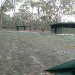 Pit toilets and Hut (bench & tables 20+ guest) with open fire place for day visitation. Plenty o