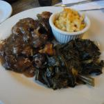 Oxtail stew with collard greens & mac and cheese