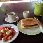 Balinese coffee with sweet milk, hot ciabatta with egg, cheese, tomato & fruits! Wonderful varie