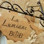 look for this pretty sign hanging over the street to help you find La Lumiane