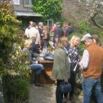 Throng outside pub entrance to garden