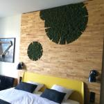 Our beautiful room- the bike frame on the wall is bamboo! Loved the moss on the headboard too.