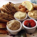 Pikilia Platter Spanakopita, Tyropita, Dolmades, Kalamari, and choice of three dips : Tzatziki,