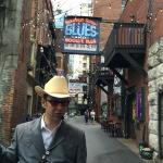 Bill our leader heading down Printers Alley.