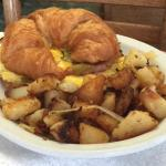 Our latest Breakfast Special-Fresh Croissant piled with Green Chile, Cheese and your choice of M