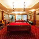 Enjoy a game of pool while watching taking in a view of the beer making process