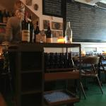 Wine station and menu behind on chalk board