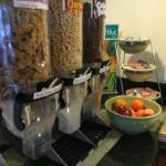 Free breakfast (waffles, eggs, sausage, muffins, pastry, toast, bagels, biscuits & gravy, yogurt