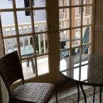 Table in the kitchen and view of back balcony