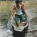 A dugout canoe that you get into and you are pulled across the river by clothesline configuratio