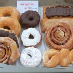 Mix of dozen doughnuts