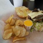 Bacon Swiss Burger with fresh Bread and Homemade Chips
