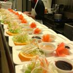 Appetizers lined up at the pass window for a large group