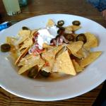 Nachos to share - crispy nachos, nice spicy salsa but not enough cheese.