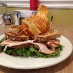 Delicious turkey club with multigrain bread, comes with house-made chips