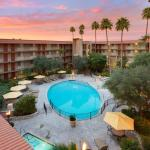 A gorgeous sunset and peaceful courtyard pool await at Embassy Suites Phoenix-Airport at 24th St