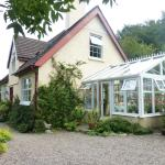 Front of house, conservatory breakfast room and parking