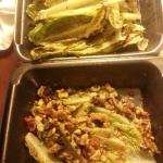 Lots of lettuce. Grilled lettuce. With some nuts on top.