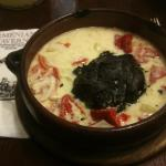 Minced meat in vine leaves and yogurt sauce