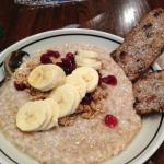 honey oatmeal with bananas,cranberries and almonds