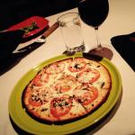 Pizza with a gluten free crust and a wonderful glass of Chianti!