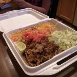 carnitas. a generous helping of tortillas is not in the photo, but came with the meal