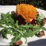 Roasted red and golden beet salad with goat cheese and arugula, candied nuts