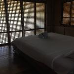 Master bedroom in family suite, very spacious, opens to balcony facing beach.