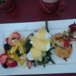 Eggs Benedict with Spinach and Asparagus with potato pancake and side of fresh fruit salad.