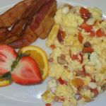 Scrambled eggs with vegetables, bacon