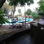 Outdoor dining area with pool