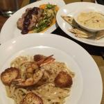 Seafood linguini, hummus appetizer, and pork loin entree. Everything was delicious!