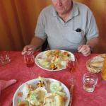"""My wife's scallop dish and my """"two fish in cream sauce"""" dish."""