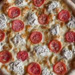 West Coast White Pizza with ricotta cheese and roma tomatoes