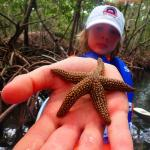 showing off his find while paddling at Ted Sperling Park Sarasota